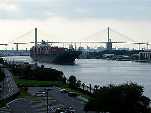 Savannah River - A cargo ship navigates the narrow Savannah River channel at Savannah
