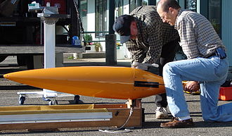 Underwater glider - Dr. Bruce Howe and Bill Felton of the University of Washington prepare a Seaglider for deployment