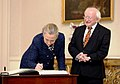 Secretary Clinton signs guestbook at Aras An Uachtarain.jpg