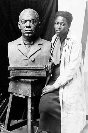 Selma Burke - Burke with her portrait bust of Booker T. Washington, c. 1935
