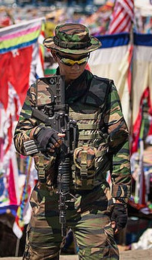 Cross border attacks in Sabah - A Malaysian Army soldier armed with Colt M4 standing guard in Sabah east coast as part of the Eastern Sabah Security Command (ESSCOM).