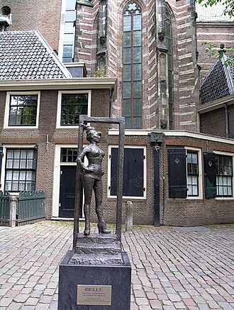 "Statue to honor the sex workers of the world. Installed March 2007 in Amsterdam, Oudekerksplein, in front of the Oude Kerk, in Amsterdam's red-light district De Wallen. Title is Belle, inscription says ""Respect sex workers all over the world."" Sex worker statue Oudekerksplein Amsterdam.jpg"