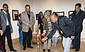Shiv Mani and Photographer Benoy K Behl, Art Historian and Photographer lighting the traditional lamp to inaugurate an Exhibit of photos on Indian Monument, part of India@ 60 Celebration in New York on September 22, 2007.jpg