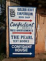 Sign for Confidant House, Margao, Goa, specifying the businesses within.jpg