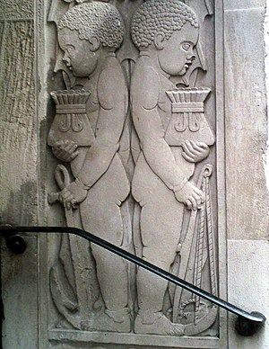 Slavery in Britain - Martins Bank building in Liverpool, showing two African boys manacled, carrying money bags.