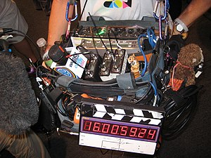 Production sound mixer - Sound technician with mixer, boom, slate and multiple wireless mic transmitters and receivers at San Diego Comic Con 2011