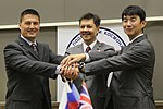 Soyuz TMA-17M crew clasp hands in Star City.jpg