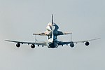 Space Shuttle Endeavour and carrier plane flying over San Francisco Bay - rear view.jpg