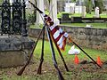 Stacked arms and flag at the dedication ceremony for the grave marker of J. R. Kealoha.jpg