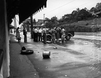 English: At a car accident, Newstead, 1952. On...
