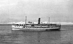 Flyer (steamboat) - Flyer on Puget Sound, sometime before 1895, looking west, with Olympic Mountains in background