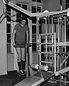 Student with the new gym equipment, c1970s.jpg