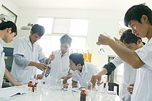 Vietnamese science students working on an experiment in their university lab. Svhutech nckh4.jpg