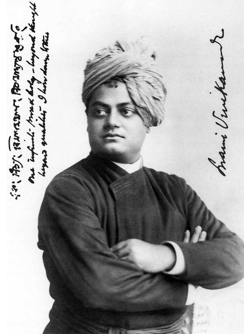 Black and white image of an Indian man, facing left with his arms folded and wearing a turban