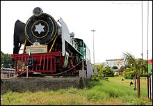 A vintage steam locomotive at the entrance of Tiruchirappalli Junction