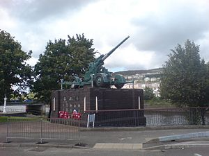 Swansea Blitz - A 3.7-inch Heavy Anti-Aircraft gun surmounts the monument erected to the air defence of Swansea, particularly the night of 21 February 1941.