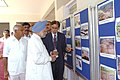 The Prime Minister, Dr. Manmohan Singh going round the photo exhibition before reviewing meeting of flood-affected areas of Karnataka, in Raichur on October 10, 2009.jpg