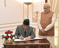 The Prime Minister of Nepal, Mr. Pushpa Kamal Dahal signing the visitor's book, at Hyderabad House, in New Delhi on September 16, 2016. The Prime Minister, Shri Narendra Modi is also seen.jpg