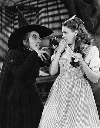 Wicked Witch of the West - Margaret Hamilton as the Witch in the 1939 film version, threatening Dorothy (Judy Garland)