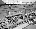 The barrel of a 9.2-inch howitzer of No. 2 Super Heavy Battery, Royal Artillery, on a railway flatcar at Dunkirk, having been transported from England on a cross-channel ferry, 20 March 1940. F3229.jpg