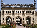 The gate to bara imambara and the labyrinth , embellished with the famous 'fish design' on the either side of the arches.JPG