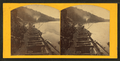Train of empty oar cars rounding the curve at Goose Lake, by Emery, A. G.png