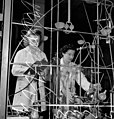 Two female laboratory workers test synthetic rubber in the Polymer Rubber Corporation plant (4679199010).jpg
