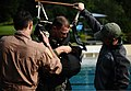 U.S. Air Force Maj. Jim Stokman, center, an A-10 Thunderbolt II aircraft pilot with the 81st Fighter Squadron, straps himself into a parachute harness during water survival training at Spangdahlem Air Base 110729-F-MS171-052.jpg