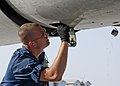 U.S. Air Force Senior Airman Todd Pagett, an E-3 Sentry aircraft fuels technician with the Sentry Aircraft Maintenance Unit, 380th Expeditionary Aircraft Maintenance Squadron, inspects the aircraft's integrated 140312-F-XR500-104.jpg