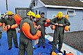 U.S. Airmen with the 305th Air Mobility Wing put on flotation devices and head gear during water survival training near Coast Guard Station Barnegat Light, N.J., Aug 110818-F-CA540-009.jpg