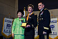 U.S. Army Capt. Amy Alexandra Rupert, center, an adjutant assigned to the 524th Military Intelligence Battalion, is recognized for her community outreach and selfless service time during the People to People 131220-A-LI672-751.jpg