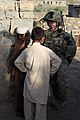U.S. Army Capt. Dana Lafarier, right, the commander of Alpha Battery, 2nd Battalion, 377th Parachute Field Artillery Regiment, Task Force 4-25, talks with children in Khoni Ghar, Khost province, Afghanistan 120527-A-PO167-059.jpg