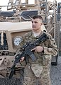U.S. Army Spc. Josh J. Arias from Canton Okla., of Company B, 1st battalion, 179th Infantry Regiment, 45th Infantry Brigade Combat Team, poses for a picture in front of a Mine Resistant Ambush Protected vehicle 110702-A-TG859-003.jpg