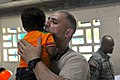 U.S. Army Spc. Souheil Sarrouh, a combat medic with the 256th Combat Support Hospital, holds a child before providing him with medical care during Medical Readiness Training Exercise as part of Beyond 130529-Z-PQ189-0468.jpg