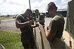 U.S. Marines with Marine Aircraft Group 12, 1st Marine Aircraft Wing prepare a makeshift barricade out of plywood at the unit's operations center during exercise Forager Fury II at Andersen Air Force Base, Guam 131127-M-UH847-004.jpg