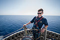 U.S. Navy Cmdr. Bo Johns, the commanding officer of the guided missile destroyer USS Stockdale (DDG 106), looks out during an inspection May 23, 2013, at the top of the mast aboard the ship in the U.S. 5th Fleet 130523-N-HN991-244.jpg