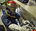 U.S. Navy Damage Controlman Fireman Apprentice Santiago Cerrillo opens a valve on the reserve air supply pack during a toxic gas drill aboard the guided missile destroyer USS Gravely (DDG 107) May 7, 2013, while 130507-N-KA046-059.jpg