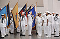 U.S. Navy Rear Adm. Joseph F. Kilkenny, commander, Naval Education and Training Command, and Sailors tasked with side boy duties salute during arrival honors at the weekly pass in review graduation ceremony in 100820-N-IK959-050.jpg