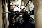 U.S. Sailors move propulsion equipment into a machinery room during maintenance activities aboard the guided missile destroyer USS Arleigh Burke (DDG 51) March 8, 2014, in Marseille, France 140308-N-WD757-084.jpg
