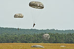 U.S. Soldiers with the 1st Battalion, 10th Special Forces Group descend to the ground at the 7th U.S. Army Joint Multinational Training Command's Grafenwoehr Training Area in Bavaria, Germany, after jumping from 130807-A-BS310-165.jpg