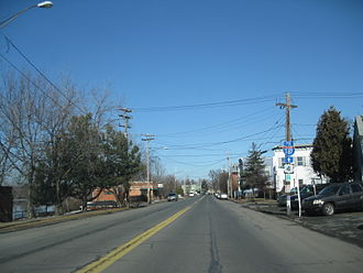 U.S. Route 4 in New York - US 4 northbound at 106th Street in Troy. At left is the Hudson River, which US 4 follows from Troy to Hudson Falls.