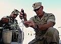 US Navy 031012-N-4943L-001 Chief Engineman Jim Winkle teaches members of the Bahrain Defense Force to build an EOD tool.jpg