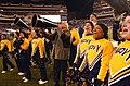 US Navy 031206-N-2568S-001 Secretary of the Navy, Gordon R. England joins the Naval Academy Cheerleaders in leading the Midshipmen in a cheer.jpg