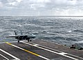 "US Navy 040225-N-4757S-028 An F-14D Tomcat assigned to the ""Black Lions"" of Fighter Squadron Two One Three (VF-213) makes an arrested landing recovery aboard USS Harry S Truman (CVN 75) during rough seas.jpg"