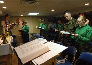 US Navy 040404-N-1522S-014 Crewmembers aboard USS George Washington (CVN 73) and her embarked Carrier Air Wing Seven (CVW-7), celebrate Palm Sunday in the ship's chapel.jpg