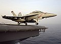 """US Navy 040728-N-3488C-003 An F-A-18F Super Hornet assigned to the """"Diamondbacks"""" from Strike Fighter Squadron One Zero Two (VFA-102) prepares to launch off the flight deck of USS Kitty Hawk (CV 63).jpg"""