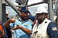 US Navy 041005-N-0021M-011 Indian Naval officer Lt. Cmdr. Amarjeet Saluja, left, an anti-submarine warfare specialist aboard the Indian Navy frigate INS Betwa (F 32), discusses underway replenishment procedures with Chief Boat.jpg
