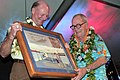 US Navy 041117-N-3228G-028 Vice Chairman and Secretary, USS Missouri Memorial Association, Robert T. Guard presents an artist's concept of the Chief Petty Officer (CPO) Legacy Center to Chief Boatswain's Mate Harold B. Estes.jpg