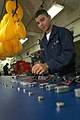US Navy 050613-N-1332Y-110 Aircrew Survival Equipmentman Airman Rodolfo Inzunza of Rio Rico, Ariz., performs functional checks on life preserving units in the Paraloft Shop aboard the conventionally powered aircraft carrier USS.jpg