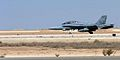 US Navy 051022-M-7404B-006 An F-A-18D Hornet, assigned to Marine Fighter Attack Squadron (All Weather) Three Three Two (VMFA(AW)-332), lands on the runway after a mission in Al Asad, Iraq.jpg